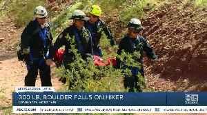 Man trapped under boulder rescued [Video]