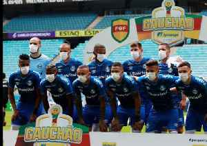Brazilian team wear masks in protest at having to play [Video]