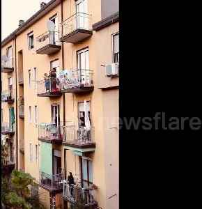 Italians sing from their rooftops amid coronavirus lockdown [Video]