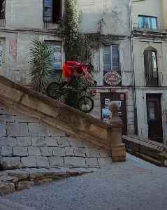 Guy Expertly Rides Bike Over Handrail of Stairs in the Streets of Girona [Video]