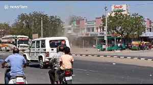 Huge dust devil whips through Indian road stalling traffic [Video]