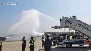 Chinese airport welcomes home flight carrying coronavirus medical workers with water arch [Video]