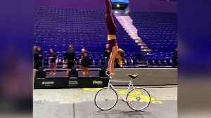 Meet the artistic cyclist who can ride a bike while doing a handstand [Video]