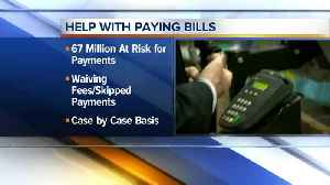 Banks assisting customers with credit card payments [Video]
