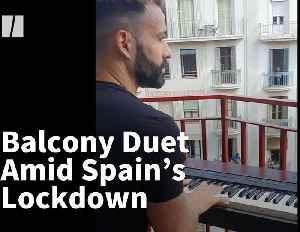 Balcony Duet During Spain's Lockdown [Video]
