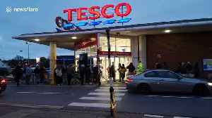 Shoppers queue outside Tesco in London at 6 a.m. [Video]