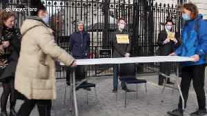 Activists block Downing Street gates with dinner table in protest to government approach to coronavirus [Video]