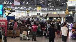 Chaos at Bangkok airport as tourists scramble to return home amid soaring coronavirus cases [Video]