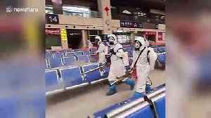 Humanitarian workers spray Wuhan train station with disinfectant after months of lockdown [Video]