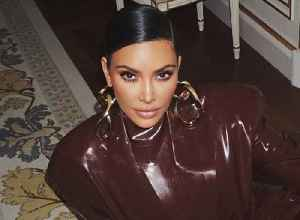 Mesmerizing video shows Kim Kardashian's struggle to get dressed [Video]