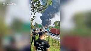 Oil tank drops from truck after collision causing huge fire on Chinese highway [Video]
