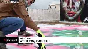 'Stay home': Greek graffiti artist sends a plea over coronavirus [Video]