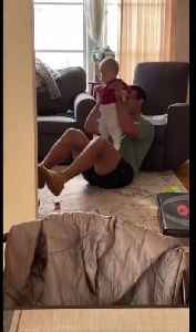 News video: Dad Lifts Baby as Weight for Home Workout While Practicing Social Distancing
