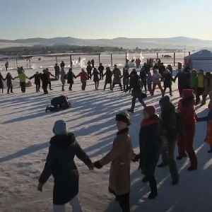 Frozen surface of world's deepest lake turned into a dance floor for traditional Russian festival [Video]