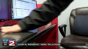 essential workforce taking precautions [Video]