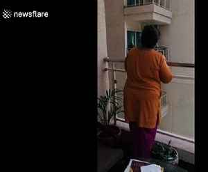 News video: Group of woman play tombola from balconies amid lockdown in India