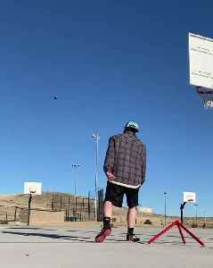 Guy Makes Trick Shot With Football [Video]