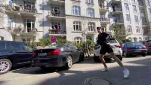 News video: Residents Exercise on Balconies as Fitness Trainer Hosts Street Workout Session