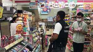 Armed police guard supermarkets in Thailand amid fears of coronavirus crime surge [Video]