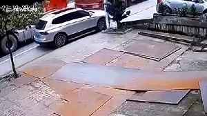 Bricks falling from transport truck after collision flatten car in south China [Video]