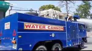 Authorities in southern India use water cannons to disinfect roads during coronavirus outbreak [Video]