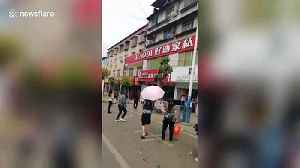 Kind-hearted neighbour rescues boy hanging from fourth-floor window in China [Video]