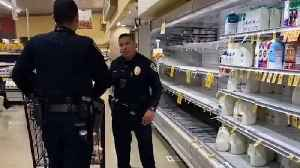 San Diego police officers help elderly man do his shopping [Video]