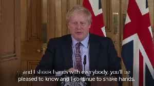 When Boris Johnson said he'd 'continue to shake hands' despite coronavirus threat [Video]