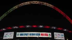 Wembley stadium lights up in Italian colours in homage to game that was supposed to be played [Video]