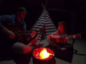 Cute moment dad creates INDOORS campfire during coronavirus lockdown [Video]