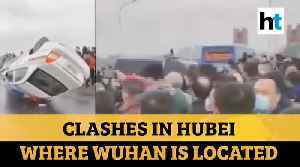 China: Violent clashes as people try to leave Coronavirus-hit Hubei province [Video]