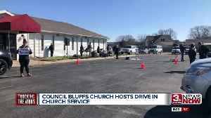 Church does drive in service to stop spread of COVID-19 [Video]