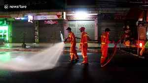 Trucks spray food markets with disinfectant to stop COVID-19 in Thailand [Video]