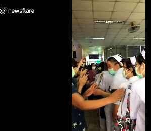Thai hospital workers clap for coronavirus nurses [Video]
