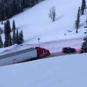 Police Car Pulls Truck Along Icy Road [Video]