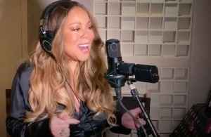 Mariah Carey performs Always Be My Baby with 'fan' blowing her hair [Video]
