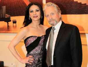 Catherine Zeta-Jones gets her wedding snaps developed two decades after marriage to Michael Douglas [Video]
