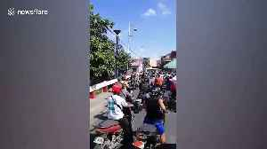 Traffic chaos in the Philippines as town enforces COVID-19 ban on outsiders entering [Video]