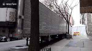 Refrigerated truck to deal with overload of dead coronavirus patients seen in NYC [Video]