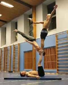 Three Shirtless Guys Perform Amazing Gymnastics Balance Trick [Video]