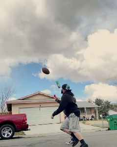 Guy Does Trick by Kicking Football and Knocking Bottle Off Girl's Head [Video]