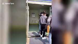 Three men apologise after aggressively jumping queue to have coronavirus tests in China [Video]