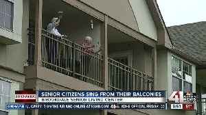 Senior Citizens sing from their balconies [Video]
