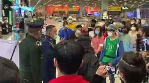 Chaos at Bangkok airport as returning Thailand residents REFUSE to go into quarantine [Video]