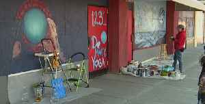 Vegas artist paints mural in Arts District [Video]