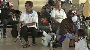 Thousands of Indonesians journey home, despite virus warnings