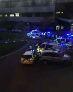 Group Of Cops Cheer For Medical Team by Blinking Lights and Clapping Outside Hospital [Video]
