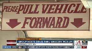 Group hosts drive-thru grocery pick-up [Video]