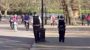 Police try to enforce social distancing in Hyde Park in London during coronavirus lockdown [Video]