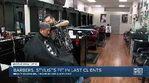 Barbers, stylists fit in last clients [Video]